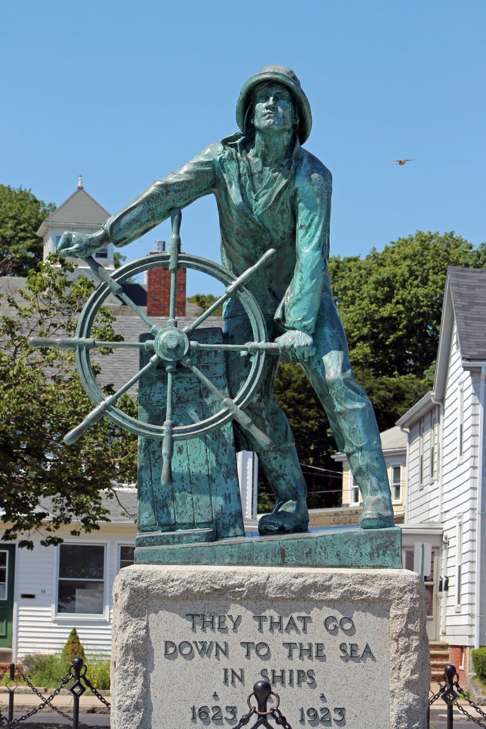 Man at the Wheel looking over Gloucester Harbor